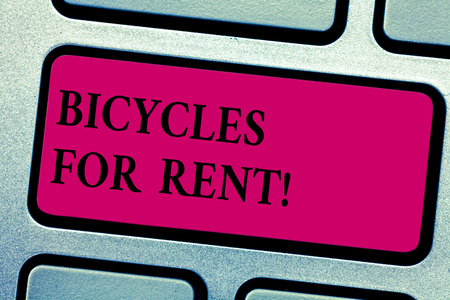 Writing note showing Bicycles For Rent. Business photo showcasing rents bikes for short periods of time usually few hours Keyboard key Intention to create computer message pressing keypad idea