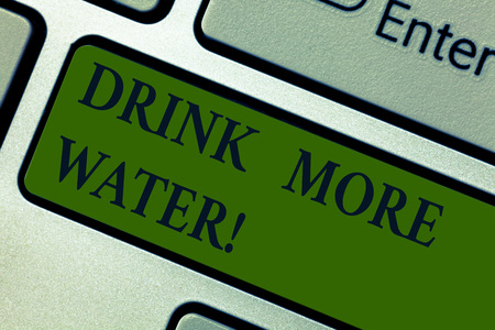 Handwriting text Drink More Water. Concept meaning increase amount of drinking water required varies everyday Keyboard key Intention to create computer message pressing keypad idea