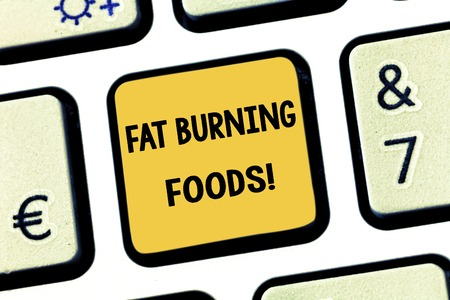 Conceptual hand writing showing Fat Burning Foods. Business photo showcasing Certain types of food burn calories as you chew them Keyboard key Intention to create computer message idea