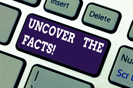 Text sign showing Uncover The Facts. Conceptual photo disclose or reveal truth about event or current situation Keyboard key Intention to create computer message pressing keypad idea Stock Photo