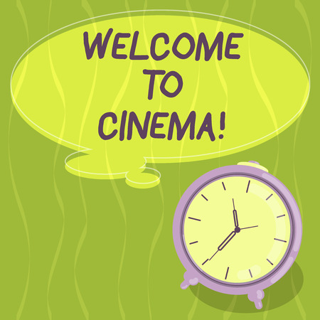 Writing note showing Welcome To Cinema. Business photo showcasing introduce someone to theatre where films shown for public Blank Color Thought Speech Bubble with Outline and Alarm Clock photo