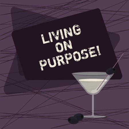Conceptual hand writing showing Living On Purpose. Business photo showcasing Achieve balance between their heart and career job Filled Cocktail Wine Glass with Olive on the Rim Text Space