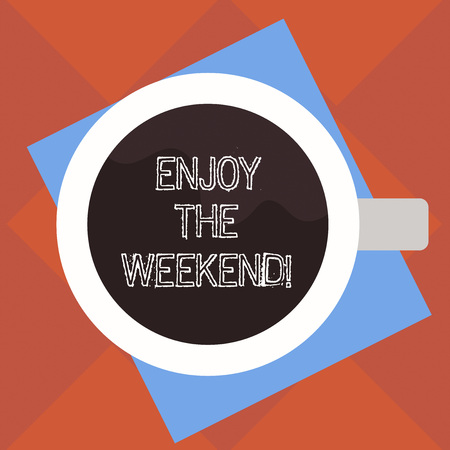 Handwriting text Enjoy The Weekend. Concept meaning day especially regarded as time for leisure and fun Top View of Drinking Cup Filled with Beverage on Color Paper photo