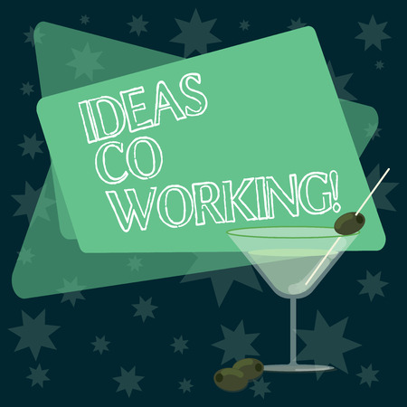 Writing note showing Ideas Co Working. Business photo showcasing use of working environment by showing who are self employed Filled Cocktail Wine Glass with Olive on the Rim Text Space