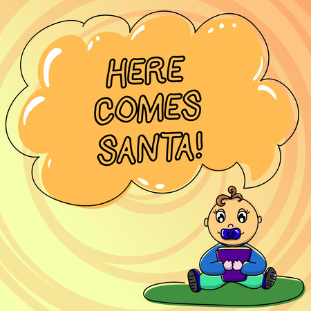 Writing note showing Here Comes Santa. Baby Sitting on Rug with Pacifier Book and Cloud Speech Bubble Stock Photo