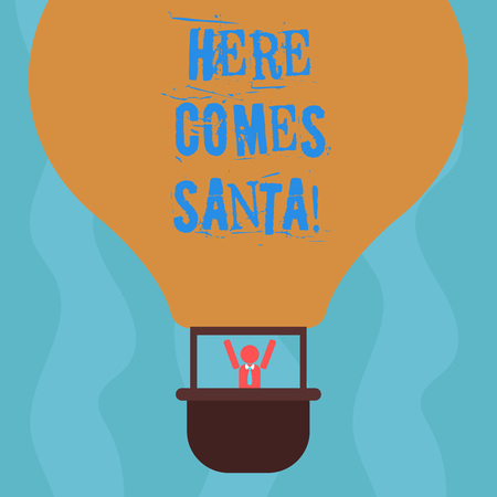 Conceptual hand writing showing Here Comes Santa. Business photo text Christmas song written and performed by Gene Autry Hu analysis Dummy Arms Raising inside Gondola Riding Air Balloon