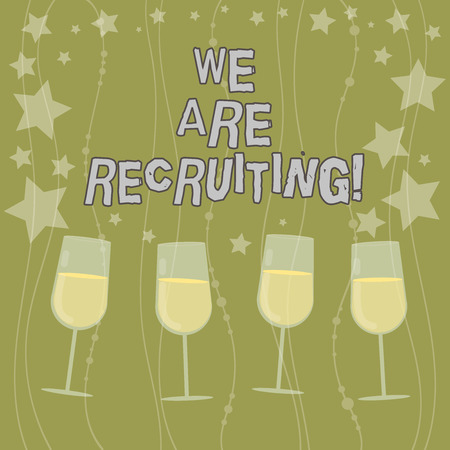 Text sign showing We Are Recruiting. Conceptual photo get someone to join something like community or job Filled Cocktail Wine Glasses with Scattered Stars as Confetti Stemware Stockfoto