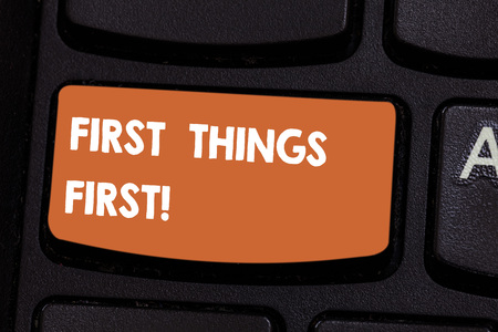 Text sign showing First Things First. Conceptual photo important matters should dealt with before other things Keyboard key Intention to create computer message pressing keypad idea Imagens