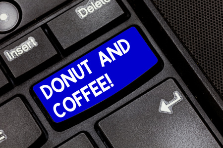 Handwriting text Donut And Coffee. Concept meaning common food and drink pairing in United States and Canada Keyboard key Intention to create computer message pressing keypad idea