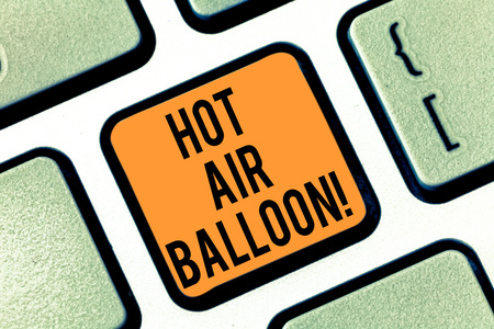 Text sign showing Hot Air Balloon. Conceptual photo Have a ride in the inside a basket flight roanalysistic trip Keyboard key Intention to create computer message pressing keypad idea