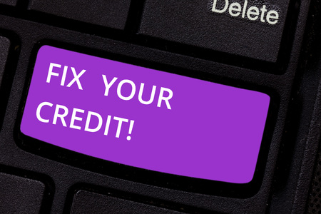 Text sign showing Fix Your Credit. Conceptual photo Keep balances low on credit cards and other credit Keyboard key Intention to create computer message pressing keypad idea
