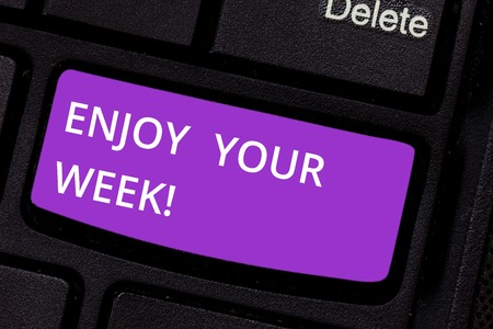 Text sign showing Enjoy Your Week. Conceptual photo Best wishes for the start of weekdays have great days Keyboard key Intention to create computer message pressing keypad idea