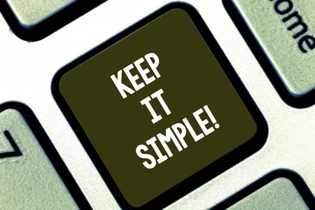 Text sign showing Keep It Simple. Conceptual photo Easy to toss around Understandable Generic terminology Keyboard key Intention to create computer message pressing keypad idea Stock Photo