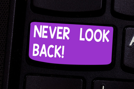 Writing note showing Never Look Back. Business photo showcasing Do not have regrets for your actions be optimistic Keyboard key Intention to create computer message pressing keypad idea Standard-Bild