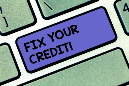 Handwriting text Fix Your Credit. Concept meaning Keep balances low on credit cards and other credit Keyboard key Intention to create computer message pressing keypad idea