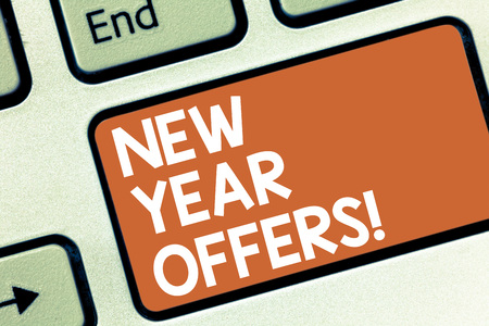 Conceptual hand writing showing New Year Offers. Business photo showcasing Final holiday season discounts price reductions sales Keyboard key Intention to create computer message idea
