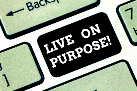 Handwriting text writing Live On Purpose. Concept meaning Have a goal mission motivation to keep going inspiration Keyboard key Intention to create computer message pressing keypad idea