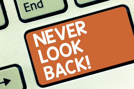 Conceptual hand writing showing Never Look Back. Business photo showcasing Do not have regrets for your actions be optimistic Keyboard key Intention to create computer message idea Standard-Bild