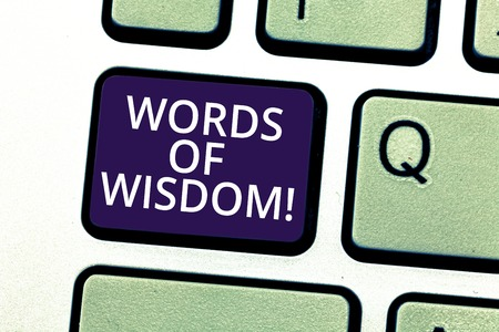 Handwriting text writing Words Of Wisdom. Concept meaning Expert advices orientation from somebody with knowledge Keyboard key Intention to create computer message pressing keypad idea