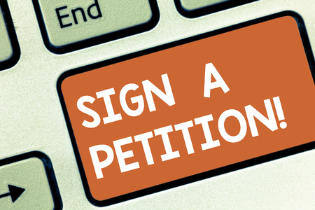 Conceptual hand writing showing Sign A Petition. Business photo showcasing Support a cause by signing paper with an agreement Keyboard key Intention to create computer message idea