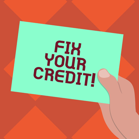 Handwriting text writing Fix Your Credit. Concept meaning Keep balances low on credit cards and other credit Drawn Hu analysis Hand Holding Presenting Blank Color Paper Cardboard photo