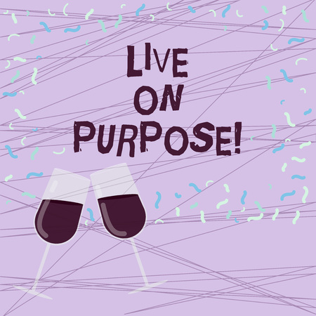 Word writing text Live On Purpose. Business concept for Have a goal mission motivation to keep going inspiration Filled Wine Glass Toasting for Celebration with Scattered Confetti photo Stock Photo