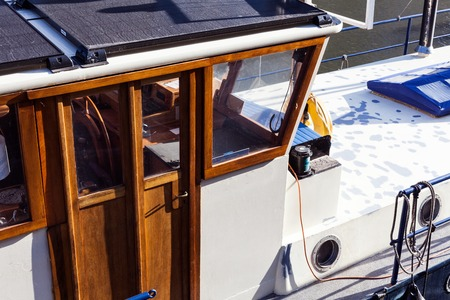 Wooden cabine on the boat on the sunny day. Nature and fishing concept with boat on the river