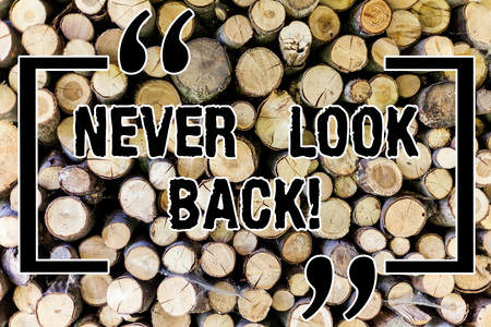 Word writing text Never Look Back. Business concept for Do not have regrets for your actions be optimistic Wooden background vintage wood wild message ideas intentions thoughts Standard-Bild