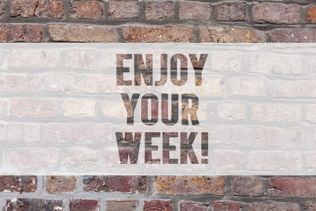 Writing note showing Enjoy Your Week. Business photo showcasing Best wishes for the start of weekdays have great days Brick Wall art like Graffiti motivational call written on the wall Stock Photo