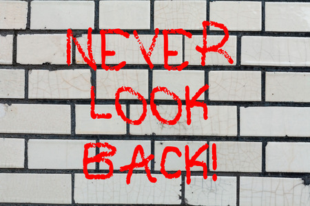 Conceptual hand writing showing Never Look Back. Business photo text Do not have regrets for your actions be optimistic Brick Wall art like Graffiti motivational call written on the wall