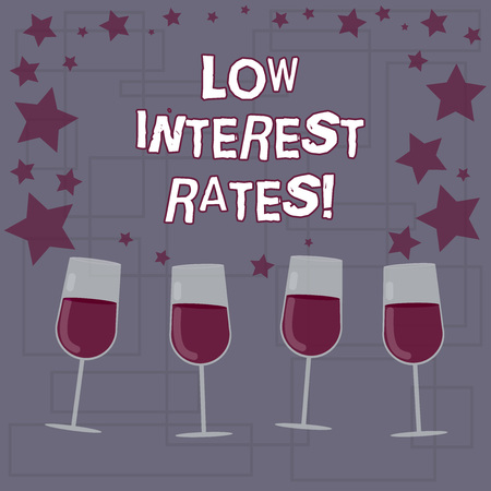Text sign showing Low Interest Rates. Conceptual photo meant to stimulate economic growth making it cheaper Filled Cocktail Wine Glasses with Scattered Stars as Confetti Stemware
