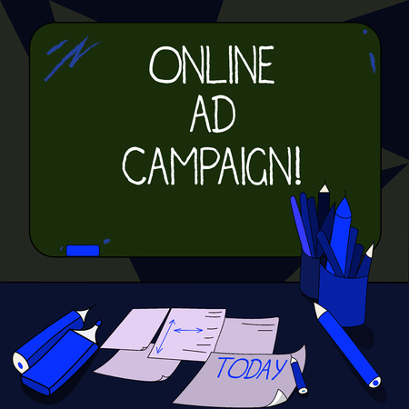 Handwriting text writing Online Ad Campaign. Concept meaning marketing effort put forward by company drive engagement Mounted Blank Color Blackboard with Chalk and Writing Tools Sheets on Desk Stock Photo