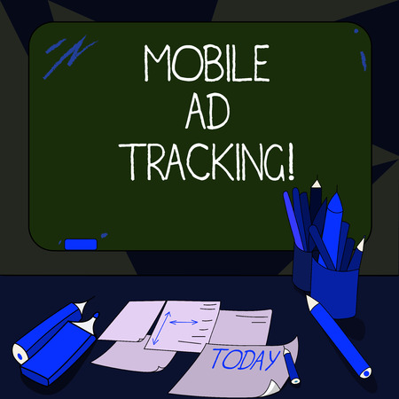 Handwriting text writing Mobile Ad Tracking. Concept meaning monitor brand perforanalysisce including advertising awareness Mounted Blank Color Blackboard with Chalk and Writing Tools Sheets on Desk Stock Photo