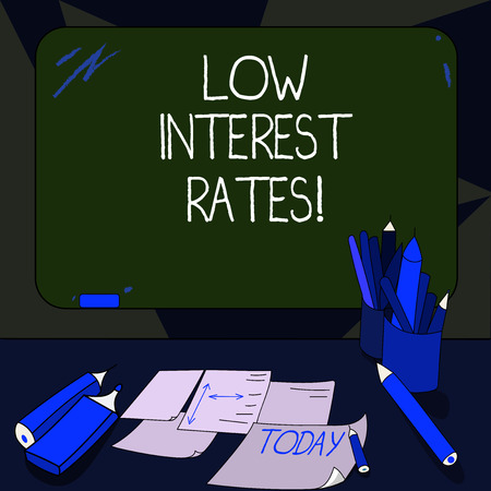 Handwriting text writing Low Interest Rates. Concept meaning meant to stimulate economic growth making it cheaper Mounted Blank Color Blackboard with Chalk and Writing Tools Sheets on Desk Reklamní fotografie