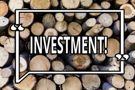 Conceptual hand writing showing Investment. Business photo showcasing To put Money Time into something to make profit Wooden background vintage wood wild message ideas thoughts
