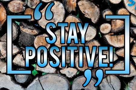 Word writing text Stay Positive. Business concept for Be Optimistic Motivated Good Attitude Inspired Hopeful Wooden background vintage wood wild message ideas intentions thoughts