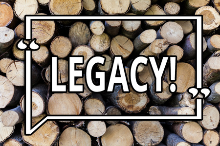 Conceptual hand writing showing Legacy. Business photo showcasing Transmitted Received from an ancestor Money Properties given by will Wooden background vintage wood wild message ideas thoughts 写真素材