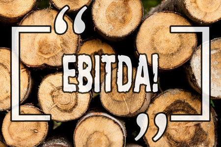 Word writing text Ebitda. Business concept for Earnings before tax is measured to evaluate company perforanalysisce Wooden background vintage wood wild message ideas intentions thoughts