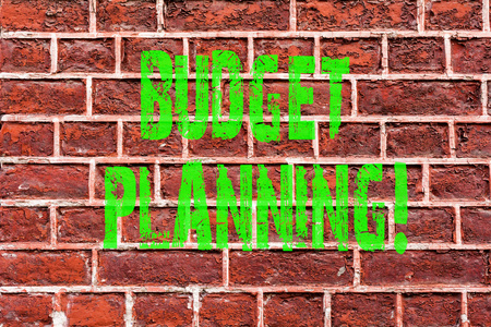 Word writing text Budget Planning. Business concept for Financial Planning Evaluation of earnings and expenses Brick Wall art like Graffiti motivational call written on the wall