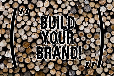 Text sign showing Build Your Brand. Conceptual photo create your own logo slogan Model Advertising E Marketing Wooden background vintage wood wild message ideas intentions thoughts