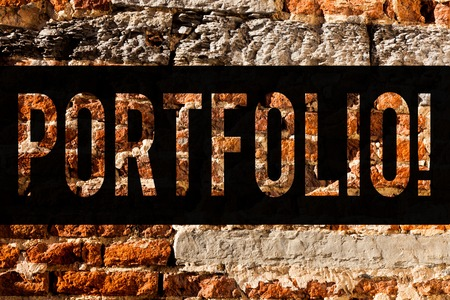 Word writing text Portfolio. Business concept for Examples of work used to apply for a job Combination of shares Brick Wall art like Graffiti motivational call written on the wall