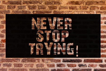 Text sign showing Never Stop Trying. Conceptual photo go on do not give up Self confidence Brick Wall art like Graffiti motivational call written on the wall Archivio Fotografico