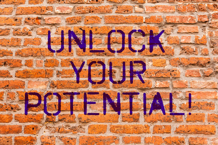 Conceptual hand writing showing Unlock Your Potential. Business photo showcasing Reveal talent Sow Skills Abilities Brick Wall art like Graffiti motivational written on wall Banco de Imagens