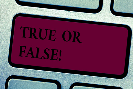 Writing note showingTrue Or False. Business photo showcasing Decide between a fact or telling a lie Doubt confusion Keyboard key Intention to create computer message pressing keypad idea Stok Fotoğraf