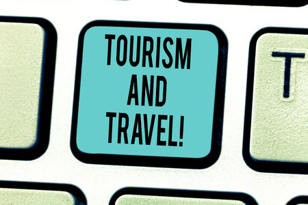 Writing note showing Tourism And Travel. Business photo showcasing business attracting accommodating entertaining tourists Keyboard key Intention to create computer message pressing keypad idea