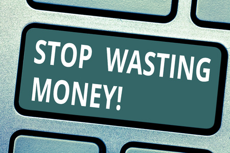 Text sign showing Stop Wasting Money. Conceptual photo avoid dissipation waste useless or profitless activity Keyboard key Intention to create computer message pressing keypad idea Stock Photo
