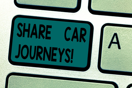Text sign showing Share Car Journeys. Conceptual photo when two or more showing travel together by vehicle Keyboard key Intention to create computer message pressing keypad idea