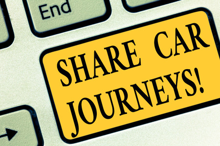 Writing note showing Share Car Journeys. Business photo showcasing when two or more showing travel together by vehicle Keyboard key Intention to create computer message pressing keypad idea