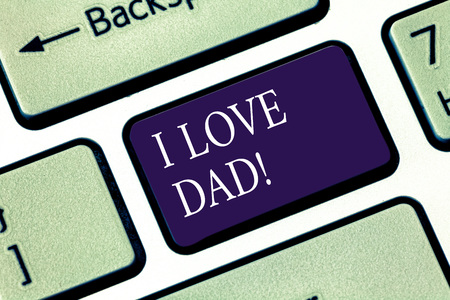 Writing note showing I Love Dad. Business photo showcasing Good feelings about my father Affection loving happiness Keyboard key Intention to create computer message pressing keypad idea