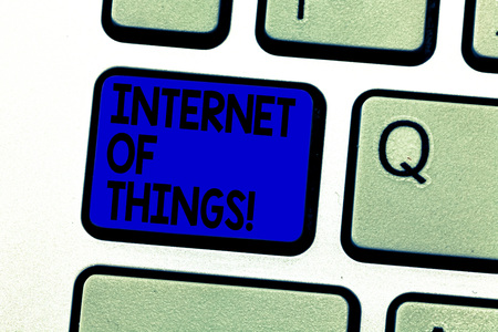 Writing note showing Internet Of Things. Business photo showcasing interconnection via Internet computing devices embedded Keyboard key Intention to create computer message pressing keypad idea
